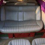 Серые кожаные кресла в салоне патибаса